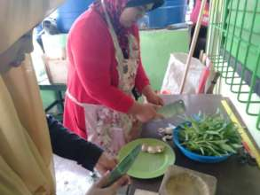 Parents prepare lunch daily with garden veggies