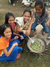 Children learning to cook own meals at school