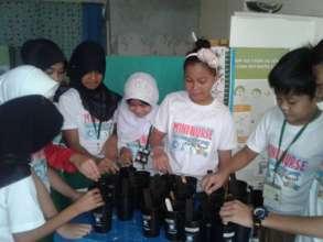 mini nurses build mosquito traps in Sulu
