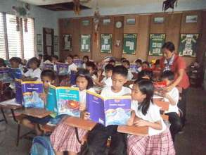 AAI books fascinate pupils at Catig Elementary
