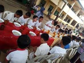 Grace before school lunch  at Godinez ES, Sulu