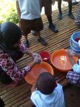 washing before lunch at Sahaya Elementary