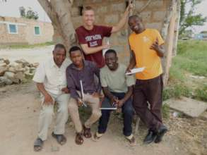 Salim working with other graduates in Taru