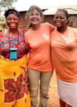 Susan with sponsored staff Clemence and her mother