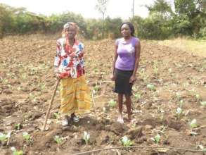 Winnie and her mother in their shamba (farm plot)