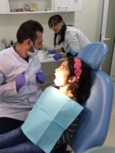 SOAR Dentist providing dental care to children