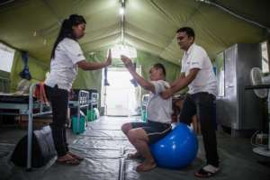 Dhan receiving physiotherapy treatment