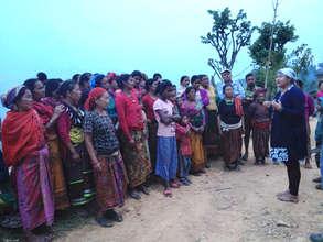 ADWAN Board member Bindu with a women's group