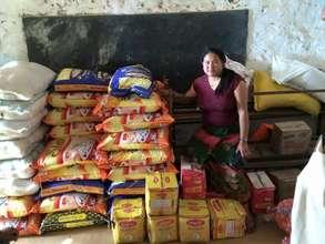 Bindu P., member of ADWAN's Board with supplies