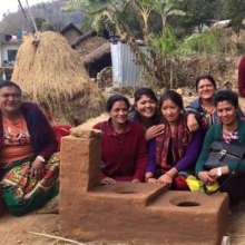 Trainers and trainees with new adobe stove