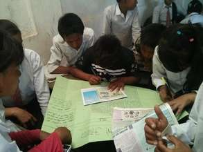 Students learning about wall magazine