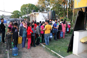 Fetching Water in Camp