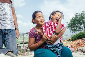 Bimal's granddaughter smiles for the camera.