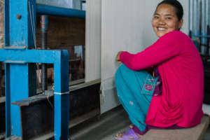 A weaver at a rebuilt GoodWeave carpet factory.