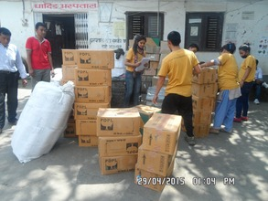 HHC Team sorting supplies for Dhading villages