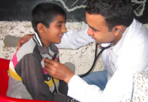 A young patient is treated at an HHC medical camp