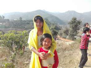 Two of our girls on a walk in Dhading