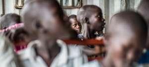 children listening to Nurse Betty teaching