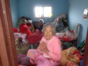 An old woman welcoming us while visiting the home