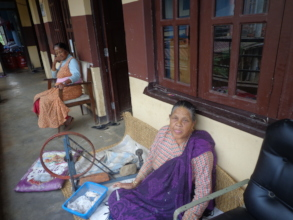 An old woman making thread