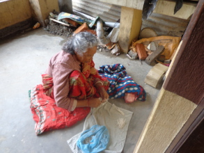 An old woman twisting  thread for oil lamp