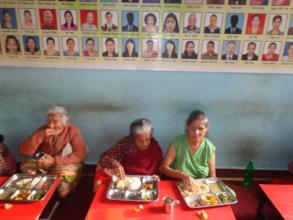 elderly people enjoying their food