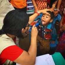 Young boy receives medical checkup