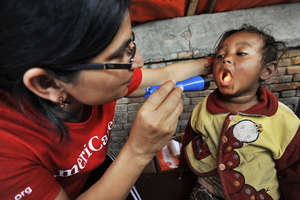 AmeriCares providing a check up for a child