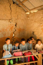 Students in a damaged and unsafe classroom
