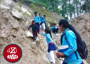 Children cross a landslide on the way to school