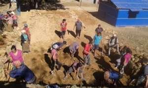 Community members volunteer and break ground