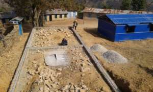 The foundation wall for one of school blocks