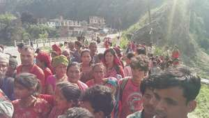 People waiting to receive survival food packages