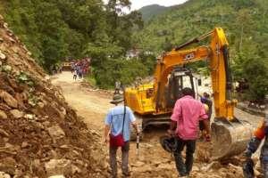 A road reopens after a landslide