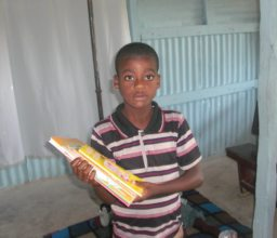 Happy student shows off new books