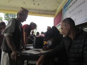 Village elderly registering to get cookstove