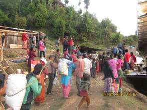 Villagers carry away their share
