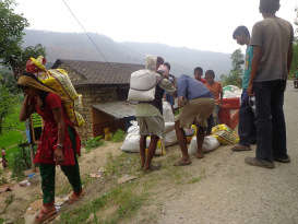 Locals carry away their share of food materials