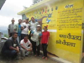 ECCA team next to the newly constructed toilet