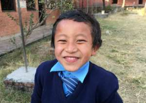 Haris, 10, one of 51 brick kids now in school