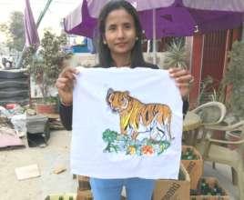 Sarita leads the embroidery training in Bardiya