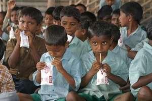 Boys drink milk at the Rajarajeswari literary cent