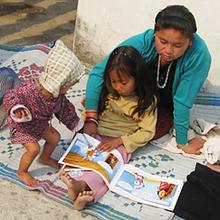 Children at an NRH reading a book