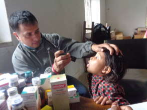 Say ahh...Young Nepali girl gets a checkup
