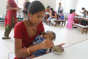 Mother Feeds her Child: Mealtime at an NRH