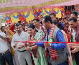 Former Kamlari Shanta Chaudhary cuts the ribbon