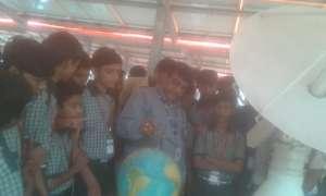 Our children understanding satellite data on globe