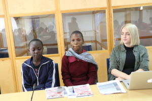 Girls preparing to make their presentations