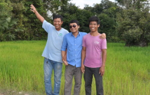 Happy Helping Hands staff surveying the new land