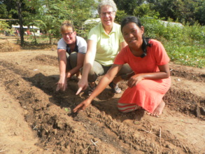 Rhi in the garden with two Food&Farming volunteers